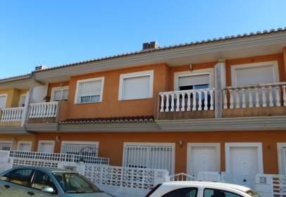 Casa adosada en calle de Mestre Serrano, nº 21